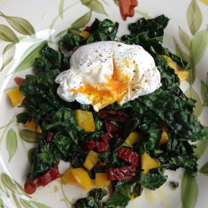Poached Egg atop Sautéed Kale